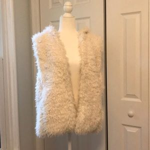 Hooded furry vest with front pockets